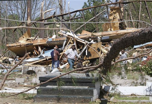 Family and friends sort through debris of a house that was swept off its foundation by a tornado that swept through the area Saturday night in  Gloucester, Va., Sunday, April 17, 2011.   <span class=meta>(AP Photo&#47; Steve Helber)</span>