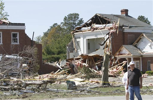"<div class=""meta ""><span class=""caption-text "">Onlookers walk buy the remains of a destroyed church damaged after a tornado swept through the area Saturday night in  Deltaville, Va., Sunday, April 17, 2011.   (AP Photo/ Steve Helber)</span></div>"