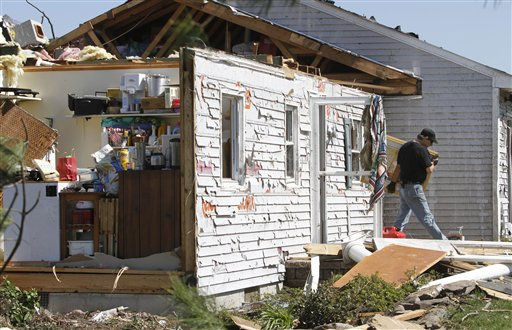 A neighbor helps sort  through debris from a tornado that swept through the area Saturday night in  Deltaville, Va., Sunday, April 17, 2011.   <span class=meta>(AP Photo&#47; Steve Helber)</span>