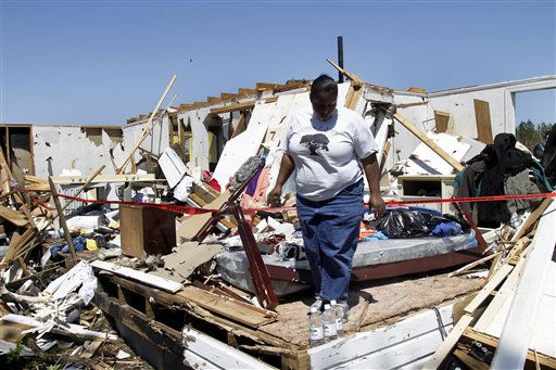 Venita Lee inspects her home in Askewville, N.C., Sunday, April 17, 2011  after a tornado moved through the area Saturday.    <span class=meta>(AP Photo&#47; Jim R. Bounds)</span>