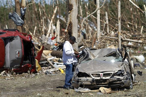 A man inspects damage to his sister&#39;s car in Askewville, N.C., Sunday, April 17, 2011 after a tornado struck Saturday.   <span class=meta>(AP Photo&#47; Jim R. Bounds)</span>