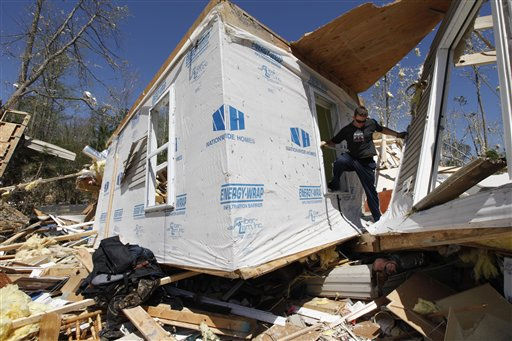 "<div class=""meta ""><span class=""caption-text "">Steve Sawyer sorts through debris of a 3,500 square foot home that was destroyed after a tornado swept through the area Saturday night in  Gloucester, Va., Sunday, April 17, 2011.   (AP Photo/ Steve Helber)</span></div>"