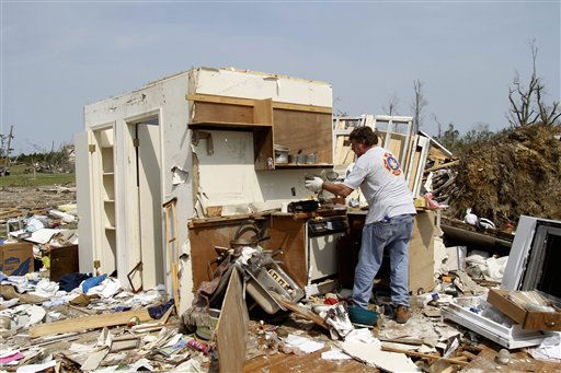 "<div class=""meta ""><span class=""caption-text "">Bill Alston cleans up what remains of a family member's home in Colerain, N.C., Monday, April 18, 2011 after a tornado ripped through the area Saturday.  (AP Photo/ Jim R. Bounds)</span></div>"