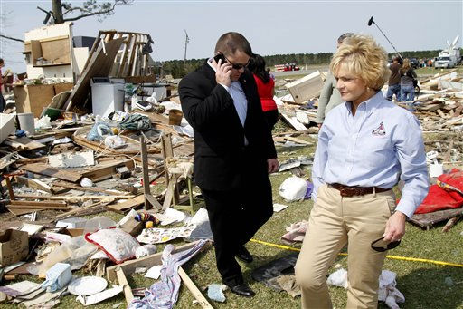 Gov. Bev Perdue tours a heavily damaged neighborhood in Colerain, N.C., Monday, April 18, 2011 after a tornado ripped through the area Saturday  <span class=meta>(AP Photo&#47; Jim R. Bounds)</span>