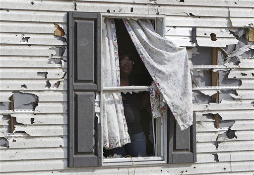 "<div class=""meta ""><span class=""caption-text "">Audrey McKoy looks out the window of her destroyed home in Ammon, N.C., Monday, April 18, 2011 after a tornado ripped through the area Saturday.  (AP Photo/ Chuck Burton)</span></div>"