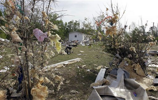 "<div class=""meta ""><span class=""caption-text "">Insulation and flooring is scattered into trees near Audrey McKay's home in Ammon, N.C., Monday, April 18, 2011 after a tornado ripped through the area Saturday.  (AP Photo/ Chuck Burton)</span></div>"