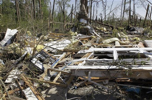 The remnants of Gary Carey&#39;s home is scattered into the trees in Roseboro, N.C., Monday, April 18, 2011 after a tornado ripped through the area Saturday.  <span class=meta>(AP Photo&#47; Chuck Burton)</span>