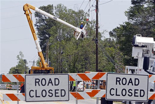 An electric company worker repairs power lines in Bonnetsville, N.C., Monday, April 18, 2011 after a tornado ripped through the area Saturday.  The violent weather began Thursday in Oklahoma, where two people died, before cutting across the Deep South on Friday and hitting North Carolina and Virginia on Saturday.   <span class=meta>(AP Photo&#47; Chuck Burton)</span>