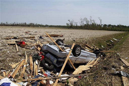 A car sits in a drainage ditch in Colerain, N.C., Monday, April 18, 2011  after a tornado ripped through the area Saturday.   <span class=meta>(AP Photo&#47; Jim R. Bounds)</span>