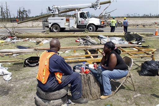 Charles Bond,left, and Gloria Williams have lunch during a break from searching for family&#39;s possessions at Bond&#39;s mother home in Colerain, N.C., Monday, April 18, 2011 after a tornado ripped through the area Saturday.   <span class=meta>(AP Photo&#47; Jim R. Bounds)</span>