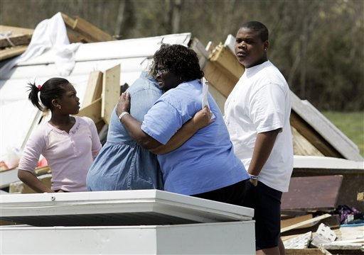 Emma Morris, right, comforts June White at Moore&#39;s Family Care Home in Colerain, N.C., Monday, April 18, 2011 after a tornado ripped through the area Saturday. <span class=meta>(AP Photo&#47; Jim R. Bounds)</span>