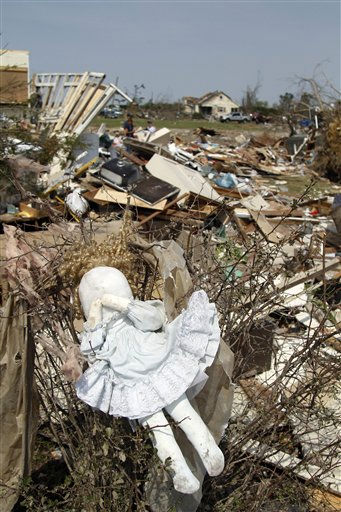 A doll hangs in a bush at a home in Colerain, N.C., Monday, April 18, 2011 after a tornado ripped through the area Saturday.   <span class=meta>(AP Photo&#47; Jim R. Bounds)</span>