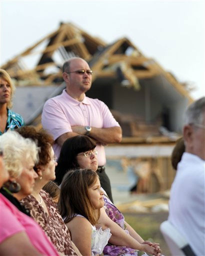 Amber Beaird, 7, bottom center, listens to the Easter sunrise service at Kendale Acres Free Will Baptist Church in Sanford, N.C., Sunday, April 24, 2011. The church is just about the only structure still standing in the neighborhood after tornados ripped through the area last week.  <span class=meta>(AP Photo&#47; Jim R. Bounds)</span>