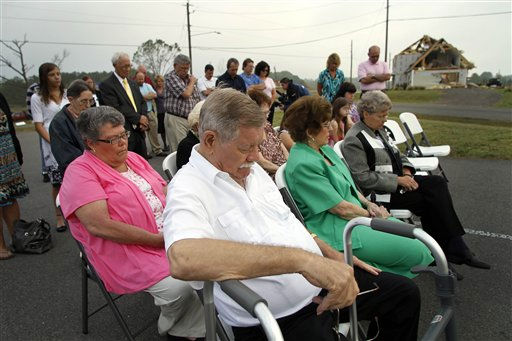 Troy Collins prays with his congregation during Easter sunrise service at Kendale Acres Free Will Baptist Church in Sanford, N.C., Sunday, April 24, 2011. The church is just about the only structure still standing in the neighborhood after tornados ripped through the area last week.  <span class=meta>(AP Photo&#47; Jim R. Bounds)</span>