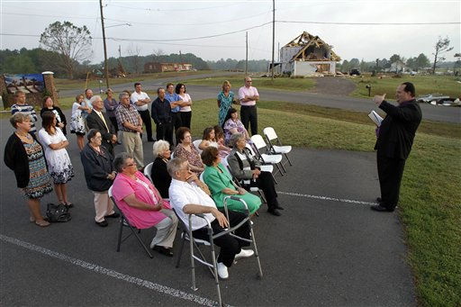 Pastor Doug Western leads his congregation in an Easter sunrise service at Kendale Acres Free Will Baptist Church in Sanford, N.C., Sunday, April 24, 2011. The church is just about the only structure still standing in the neighborhood after tornados ripped through the area last week.   <span class=meta>(AP Photo&#47; Jim R. Bounds)</span>