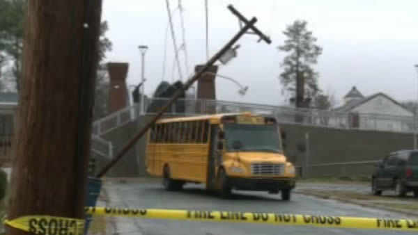 "<div class=""meta ""><span class=""caption-text "">A power pole toppled over on a school bus in Durham. (WTVD Photo/ Julian Harrison)</span></div>"
