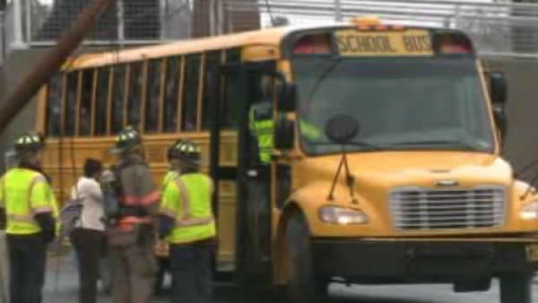 A power pole toppled over on a school bus in Durham. <span class=meta>(WTVD Photo&#47; Julian Harrison)</span>