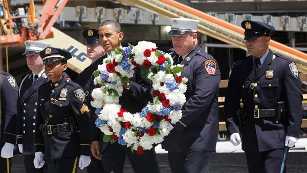 Obama pays somber respects at 9/11 ground zero