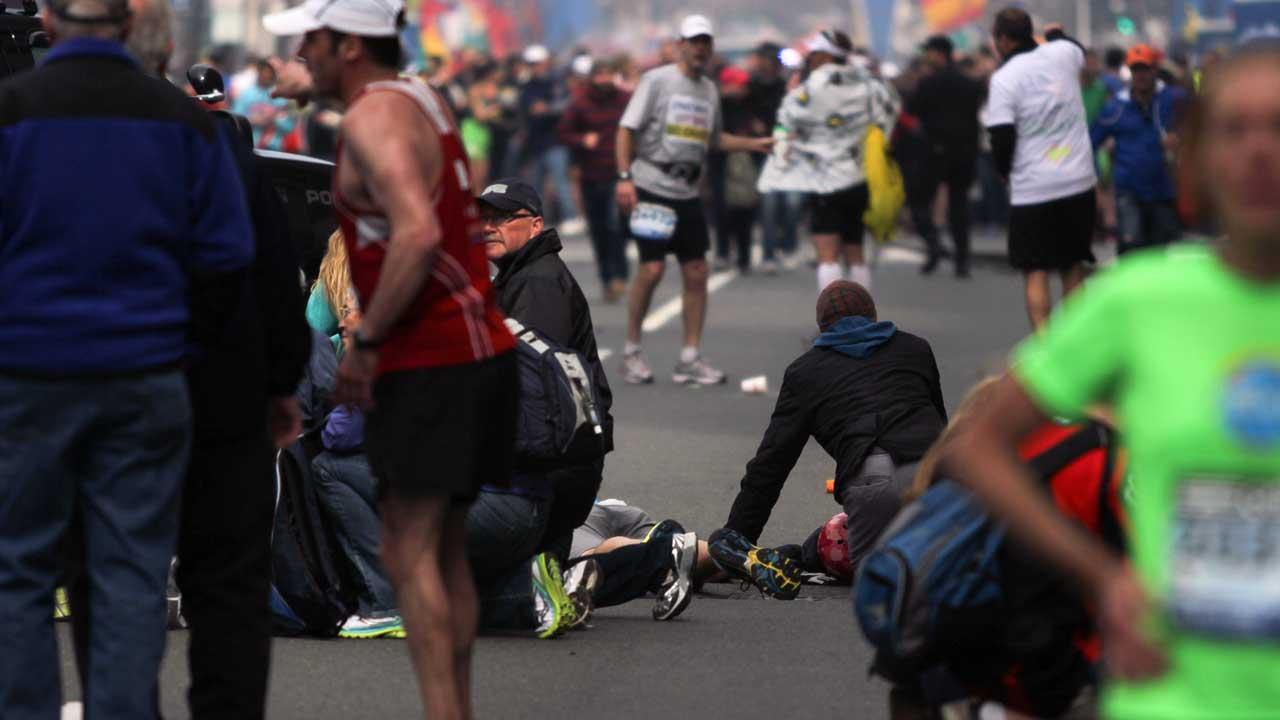 In this photo provided by The Daily Free Press and Kenshin Okubo, people react to an explosion at the 2013 Boston Marathon in Boston, Monday, April 15, 2013. <span class=meta>(AP Photo&#47;The Daily Free Press, Kenshin Okubo)</span>