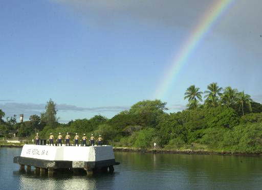 Marines prepare for the traditional 21-gun salute as part of Thursday&#39;s Dec, 7, 2000 at ceremonies marking the 59th anniversary of the Japan&#39;s attack on Pearl Harbor, aboard the USS Arizona Memorial in Pearl Harbor, Hawaii. A rainbow over Ford Island graced the solemn ceremony during a moment of silence at the 7:55 a.m. local time, the hour the attack began.  <span class=meta>(AP Photo&#47; RONEN ZILBERMAN)</span>