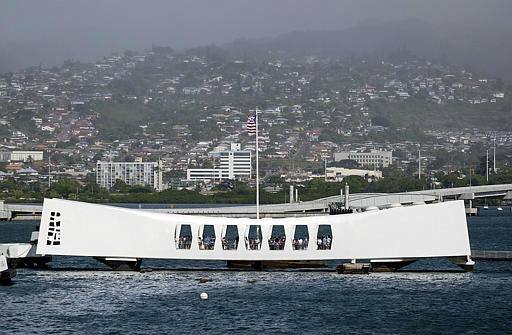 The Arizona Memorial is seen here viewed for the deck of the Battleship Missouri in Pearl Harbor, Wednesday, Dec. 5, 2001, in Honolulu.  Friday, Dec. 7, 2001 marks the 60th anniversary of the Japanese attack on Pearl Harbor. <span class=meta>(AP Photo&#47; MARK J. TERRILL)</span>