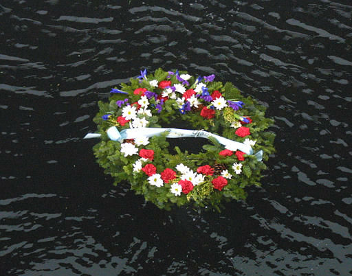 A memorial reef floats in Everett Harbor, tossed by the Seattle veteran&#39;s Pearl Harbor members at Naval Base Everett, Wash., Sunday, Dec. 7, 2003. The veterans came to remember the events of the Japanese raid on Pearl Harbor in the 20 minute ceremony at the base.  <span class=meta>(AP Photo&#47; RALPH RADFORD)</span>