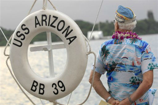A survivor of the 1941 attack on Pearl Harbor overlooks the water near a replica lifesaver during the 65th anniversary ceremony in Pearl Harbor, Hawaii, Thursday, Dec. 7, 2006.  <span class=meta>(AP Photo&#47; LUCY PEMONI)</span>