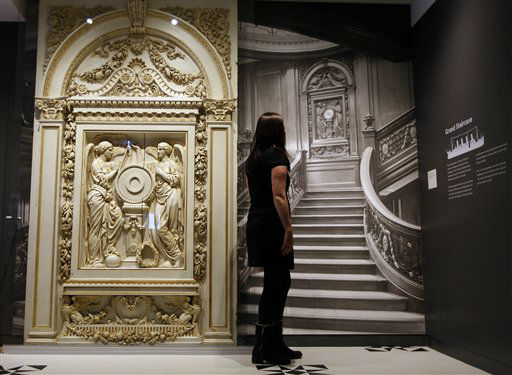 "<div class=""meta ""><span class=""caption-text "">A woman looks at a photograph of the Grand Staircase from the Titanic, at SeaCity Museum in Southampton, England,Tuesday, April 3, 2012. The new museum will open in the City of Southampton on April 10, 100 years after the ill fated Titanic sailed from the City's docks. (AP Photo/Kirsty Wigglesworth)</span></div>"