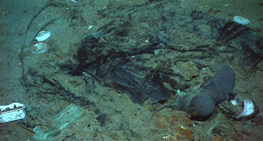 "<div class=""meta ""><span class=""caption-text "">This photo provided by the Institute for Exploration, Center for Archaeological Oceanography/University of Rhode Island/NOAA Office of Ocean Exploration, shows The remains of a coat and boots, articulated in the mud on the sea bed near Titanic's stern, are suggestive evidence of where a victim of the disaster came to rest. (AP Photo/Institute for Exploration, Center for Archaeological Oceanography/University of Rhode Island/NOAA Office of Ocean Exploration)</span></div>"