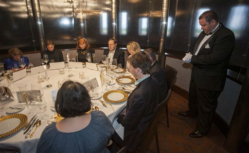 "<div class=""meta ""><span class=""caption-text "">Maitre de Ryan Roberts leads guests in a moment of silence for the 1514 people who died when the RMS Titanic sank during a re-creation of the final first class dinner served on the ship, Saturday, April 14, 2012, in Houston. The Titanic sank in the North Atlantic Ocean April 15, 1912 after colliding with an iceberg during her maiden voyage from Southampton, England to New York. (AP Photo/Dave Einsel)</span></div>"