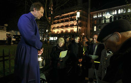 "<div class=""meta image-caption""><div class=""origin-logo origin-image ""><span></span></div><span class=""caption-text"">Dean John Mann holds a moment of silence outside Belfast City Hall following a service in commemoration of the Titanic at St. Ann's Cathedral, in Belfast, Northern Ireland, Saturday, April 14, 2012. A century after the great ship went down with the loss of 1,500 lives, events around the globe are marking a tragedy that retains a titanic grip on the world's imagination-an icon of Edwardian luxury that became, in a few dark hours 100 years ago, an enduring emblem of tragedy. (AP Photo/Peter Morrison)</span></div>"