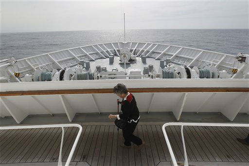 "<div class=""meta ""><span class=""caption-text "">A passenger walks on the deck as the MS Balmoral Titanic memorial cruise ship approaches the wreck site of the Titanic in the Atlantic Ocean, Saturday, April 14, 2012. A century after the great ship went down with the loss of 1,500 lives, events around the globe are marking a tragedy that retains a titanic grip on the world's imagination _ an icon of Edwardian luxury that became, in a few dark hours 100 years ago, an enduring emblem of tragedy. (AP Photo/Lefteris Pitarakis)</span></div>"