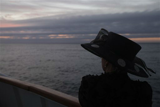 "<div class=""meta ""><span class=""caption-text "">Helena Beaumont-Jones from Airlie Beach, Australia reflects as the MS Balmoral Titanic memorial cruise ship approaches the final resting place of the Titanic in the Atlantic Ocean, Saturday, April 14, 2012. A century after the great ship went down with the loss of 1,500 lives, events around the globe are marking a tragedy that retains a titanic grip on the world's imagination - an icon of Edwardian luxury that became, in a few dark hours 100 years ago, an enduring emblem of tragedy. (AP Photo/Lefteris Pitarakis)</span></div>"