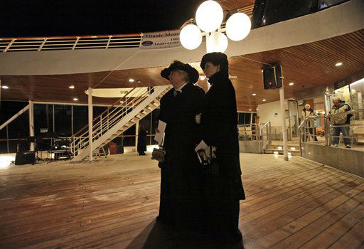Passengers Maurine Beechler, left, and her daughter Amy Marie, both from Buffalo, NY, reflect following a memorial service, marking the 100th year anniversary of the Titanic disaster, aboard the MS Balmoral Titanic memorial cruise ship, at the wreck site in the North Atlantic Ocean, early Sunday, April 15, 2012. Aboard the Balmoral, a cruise ship taking history buffs and descendants of Titanic victims on the route of the doomed voyage, passengers and crew hold two ceremonies at the site of the disaster, 640 kilometers (400 miles) off the coast of Newfoundland - one marking the time when the ship hit the iceberg, the other the moment it sank below the waves. (AP Photo/Lefteris Pitarakis)