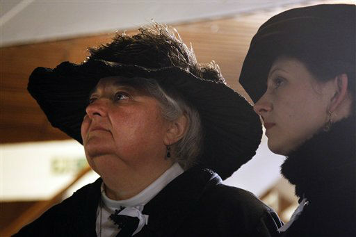 Passengers Maurine Beechler, left, and her daughter Amy Marie, both from Buffalo, NY, reflect following a memorial service, marking the 100th year anniversary of the Titanic disaster, aboard the MS Balmoral Titanic memorial cruise ship, at the wreck site in the North Atlantic Ocean, early Sunday, April 15, 2012. Aboard the Balmoral, a cruise ship taking history buffs and descendants of Titanic victims on the route of the doomed voyage, passengers and crew hold two ceremonies at the site of the disaster, 640 kilometers(400 miles) off the coast of Newfoundland - one marking the time when the ship hit the iceberg, the other the moment it sank below the waves. (AP Photo/Lefteris Pitarakis)
