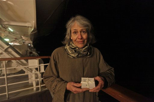 Helen Edwards, 62, from Silver Spring, Maryland holds a box with ashes of family friend Adam Lackey, a Titanic buff from Montana who died last year as the MS Balmoral Titanic memorial cruise ship reaches the wreck site of the Titanic in the Atlantic Ocean, late Saturday, April 14, 2012.  Edwards hold her own private act of remembrance. She scattered the ashes at the wreck site, as per family wishes. (AP Photo/Lefteris Pitarakis)