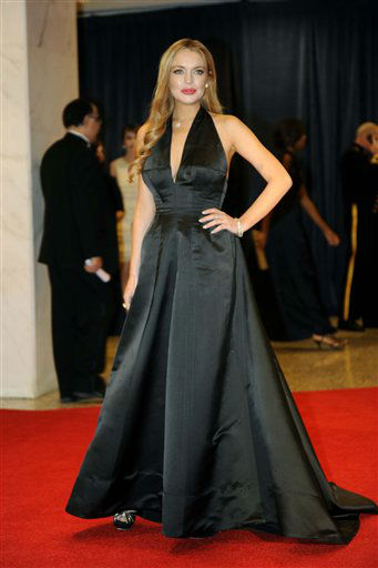Actress Lindsay Lohan arrives at the White House Correspondents' Association Dinner on Saturday, April 28, 2012, in Washington. (AP Photo/Kevin Wolf)