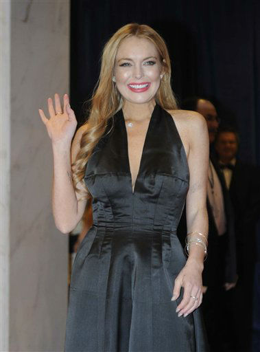 "<div class=""meta image-caption""><div class=""origin-logo origin-image ""><span></span></div><span class=""caption-text"">Actress Lindsay Lohan arrive at the White House Correspondents' Association Dinner on Saturday, April 28, 2012, in Washington.  (AP Photo/Kevin Wolf)</span></div>"