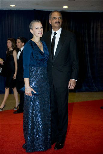 Attorney General Eric Holder and his wife, Sharon Malone, arrives at the White House Correspondents' Association Dinner on Saturday, April 28, 2012 in Washington.  (AP Photo/Kevin Wolf)