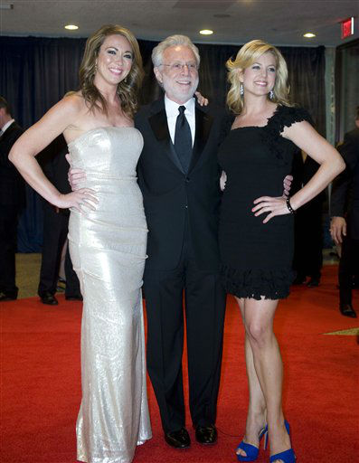 "<div class=""meta ""><span class=""caption-text "">Journalist Wolf Blitzer, center, arrives at the White House Correspondents' Association Dinner with his guests on Saturday, April 28, 2012, in Washington. (AP Photo/Kevin Wolf)</span></div>"