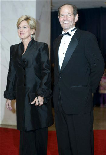 Former New York Gov. Eliot Spitzer, right, arrives at the White House Correspondents' Association Dinner on Saturday, April 29, 2012, in Washington. (AP Photo/Kevin Wolf)