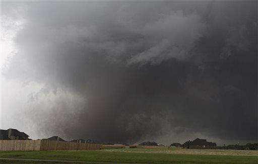 A tornado moves past homes in Moore, Okla. on Monday, May 20, 2013. A monstrous tornado roared through the Oklahoma City suburbs, flattening entire neighborhoods with winds up to 200 mph, setting buildings on fire and landing a direct blow on an elementary school. &#40;AP Photo&#47;Alonzo Adams&#41; <span class=meta>(AP Photo&#47; Alonzo Adams)</span>