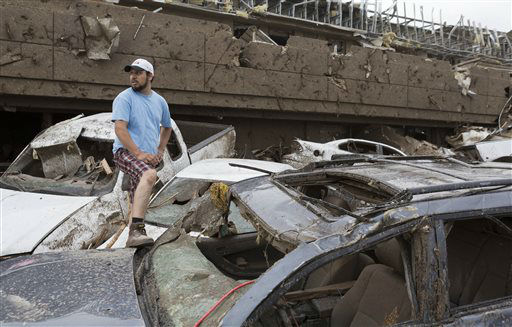 "<div class=""meta ""><span class=""caption-text "">Antonio Flores of Moore, Okla. searches for his car after a tornado damaged the Moore Medical Center and the vehicles in the parking lot in Moore, Okla. on Monday, May 20, 2013. (AP Photo/Alonzo Adams) (AP Photo/ Alonzo Adams)</span></div>"