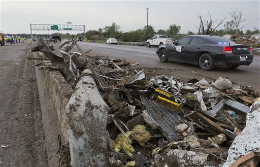 Debris lays on the northbound lanes of I-35 just south of SW 4th street in Moore, Okla. after a tornado moves through the area on Monday, May 20, 2013. &#40;AP Photo&#47;Alonzo Adams&#41; <span class=meta>(AP Photo&#47; Alonzo Adams)</span>