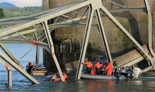 In this photo provided by Francisco Rodriguez, rescue workers head to the scene where a pickup truck and a car fell into the Skagit River after the collapse of the Interstate 5 bridgeThursday, May 23, 2013, in Mount Vernon, Wash. &#40;AP Photo&#47;Francisco Rodriguez&#41; <span class=meta>(AP Photo&#47; Francisco Rodriguez)</span>