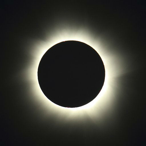 This photo provided by Tourism Queensland shows a total solar eclipse observed on Green Island, Queensland state, Australia, Wednesday, Nov. 14, 2012.