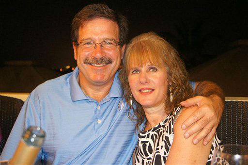 "<div class=""meta ""><span class=""caption-text "">In this undated photo provided by Mark Sherlach, Mark Sherlach and his wife, school psychologist Mary Sherlach, pose for a photo. Mary Sherlach was killed Friday, Dec. 14, 2012, when a gunman opened fire at Sandy Hook Elementary School, in Newtown, Conn., killing 26 children and adults at the school.  (AP Photo/ Courtesy of Mark Sherlach)</span></div>"