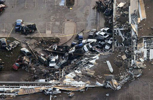 This aerial photo shows the Moore Medical center in Moore, Okla., following a tornado Monday, May 20, 2013. A tornado roared through the Oklahoma City suburbs Monday, flattening entire neighborhoods, setting buildings on fire and landing a direct blow on an elementary school. &#40;AP Photo&#47;Steve Gooch&#41; <span class=meta>(AP Photo&#47; Steve Gooch)</span>