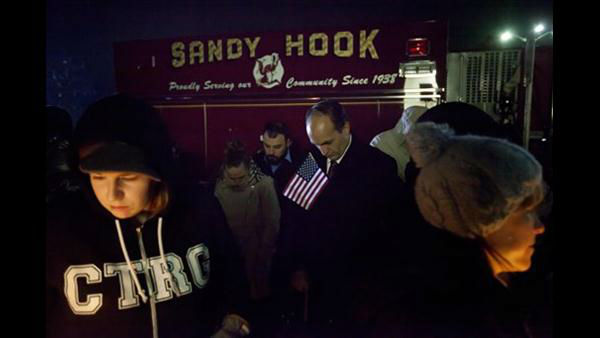 Mourners listen to a memorial service over a loudspeaker outside Newtown High School for the victims of the Sandy Hook Elementary School shooting, Sunday, Dec. 16, 2012, in Newtown, Conn.  <span class=meta>(AP Photo&#47;David Goldman)</span>