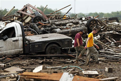 Two men walk through debris just east of Western and north of SW 149th after a tornado struck south Oklahoma City and Moore, Okla., Monday, May 20, 2013. &#40;AP Photo&#47; The Oklahoman, Nate Billings&#41; <span class=meta>(AP Photo&#47; NATE BILLINGS)</span>
